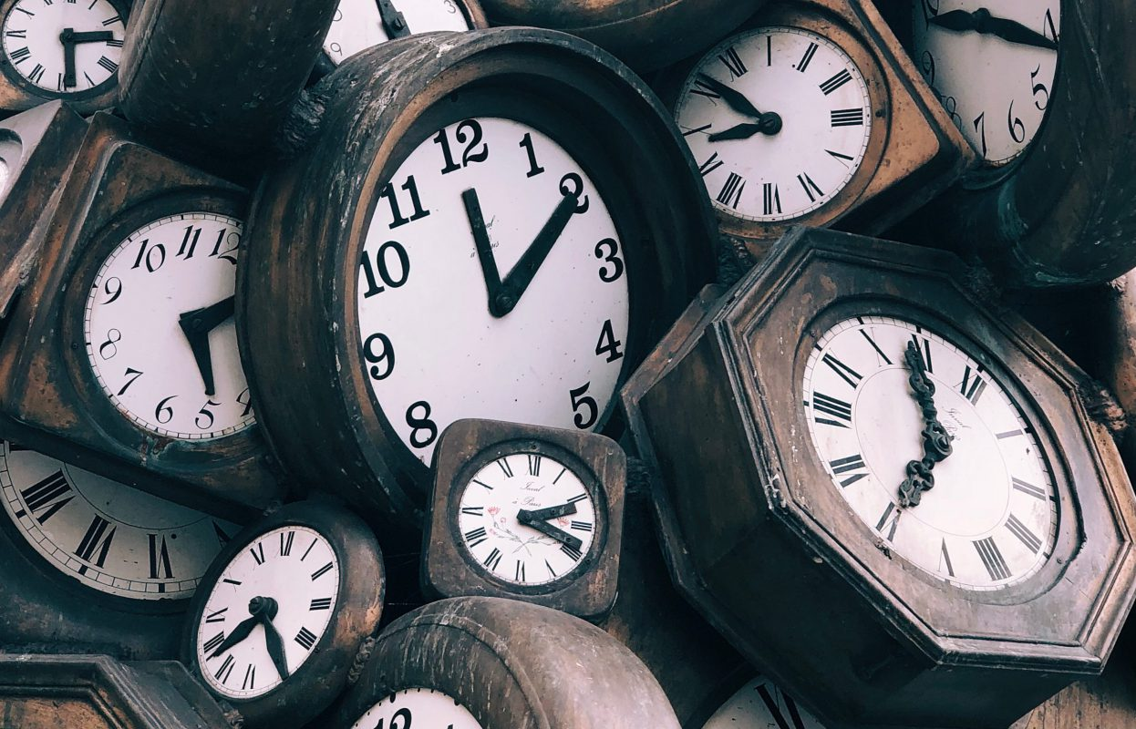 This image of a pile of clocks emphasizes that real estate lead generation takes time.